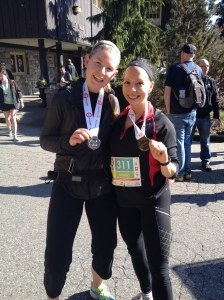 Kirstie and I showing off the medals we got, even though one of us didn't pay an entry fee....
